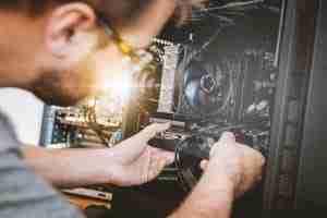 Person repairing a computer